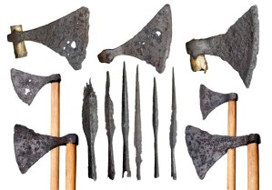 Viking weapons from the Thames. Selection of iron axes and spearheads. The wooden handles are modern additions. In the late 900s and early 1000s Scandinavian rulers like Swein Forkbeard of Denmark and Olaf Tryggvason of Norway tried to gain control of the Danelaw and of the rest of England, and eventually Swein's son Cnut won the English throne. There were a number of battles along the Thames and around London Bridge. On one occasion the bridge was pulled down. These battle axes and spears were found during building works at the north end of London Bridge in the 1920s. They may have been lost in battle or thrown into the river by the victors in celebration.